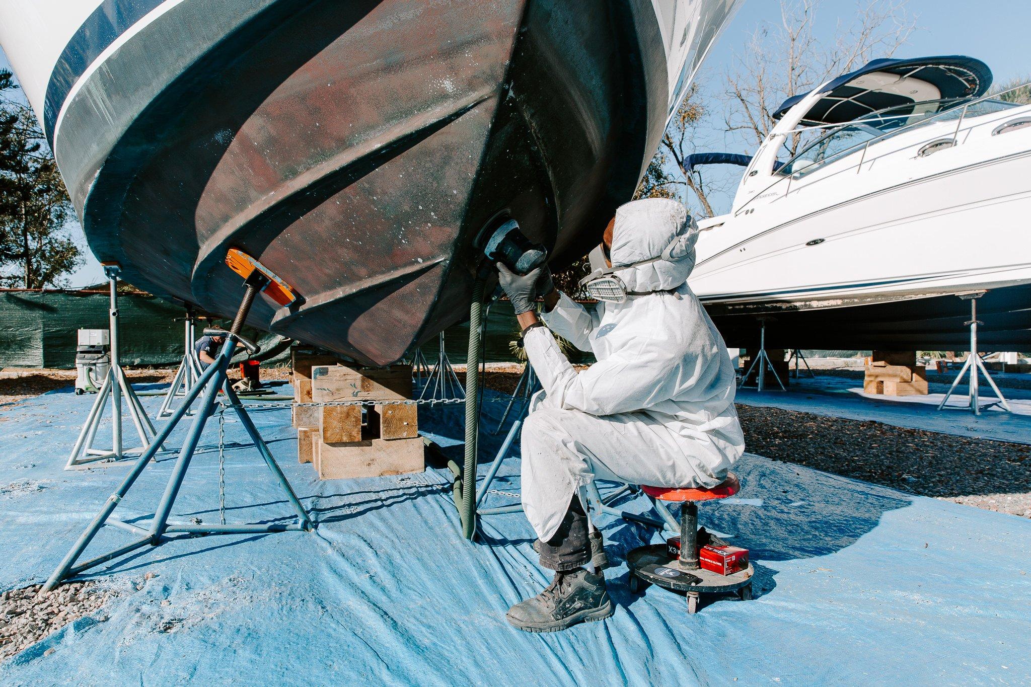 worker working on bottom boat job